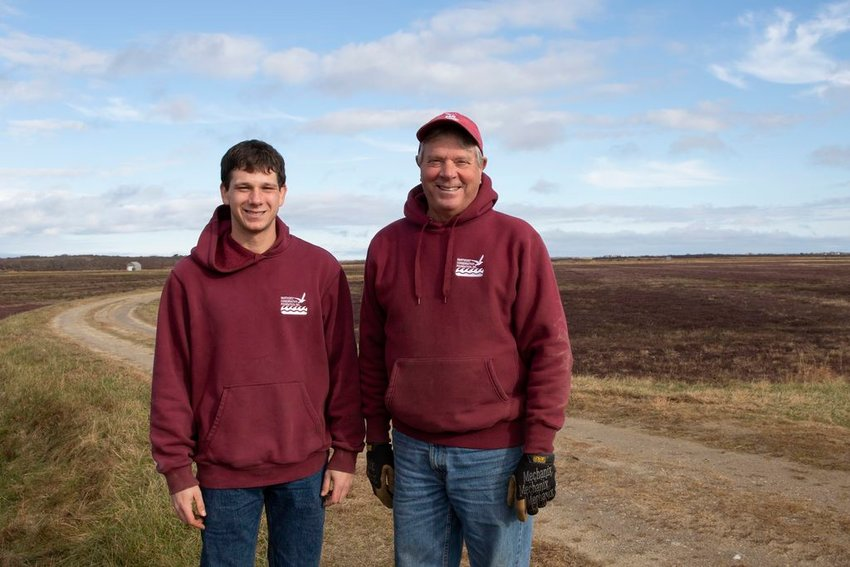 Nick Larrabee, left, and his father Tom at the Nantucket Conservation Foundation's Milestone Cranberry Bog this week.