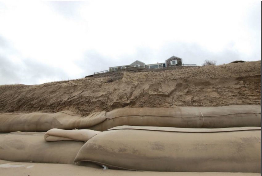 Geotextile tubing along 1,000 feet of the base of the Sankaty Bluff intended to protect the homes above from erosion.