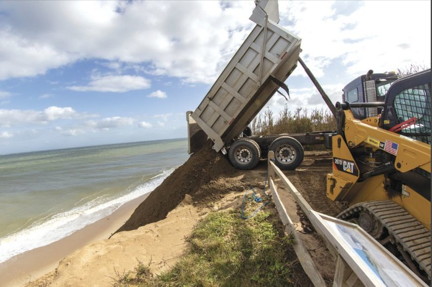 The Sconset Beach Preservation Fund replenishes sand on its erosion-control project at the base of the Sankaty Bluff.