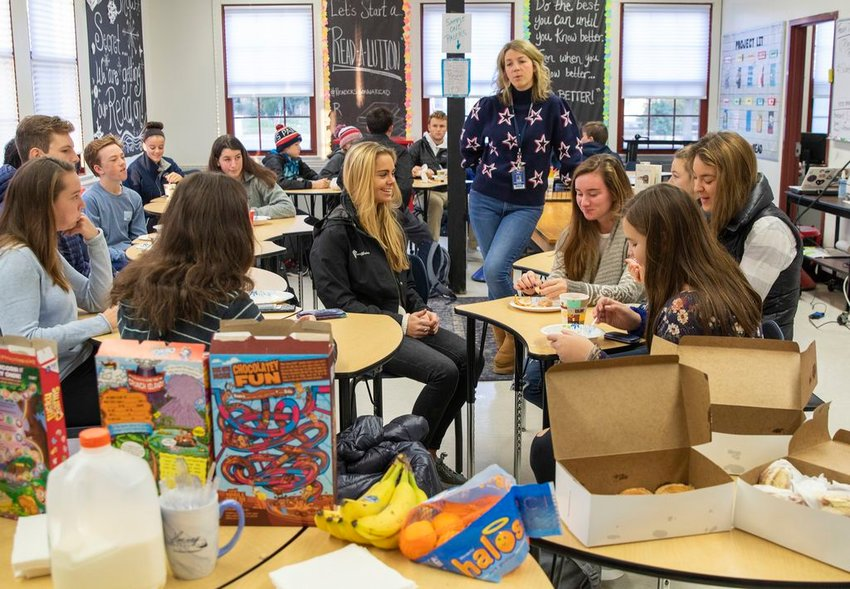 Teacher Liz Reinemo addresses a group of students participating in the Harvey Foundation's M.E.A.L. Program breakfast in Adriene Lombardi's classroom Friday morning before the start of school.