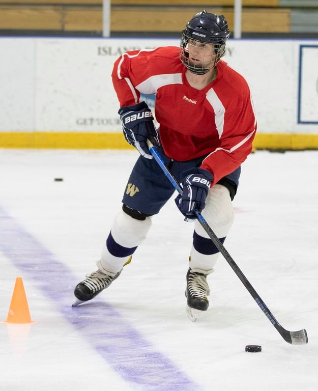 Alex Gibson crosses the blue line during boys hockey practice Friday. The Whalers plan to play an up-tempo style of hockey this year.