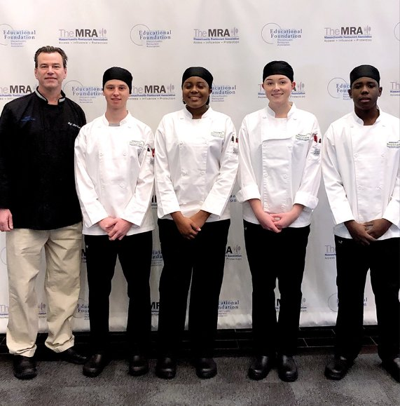 Nantucket High School culinary teacher Tom Proch, left, with students Vainius Valentukevicius, Malkia Blake, Sydney Higgins and Michael Bartley Tuesday at Gillette Stadium.