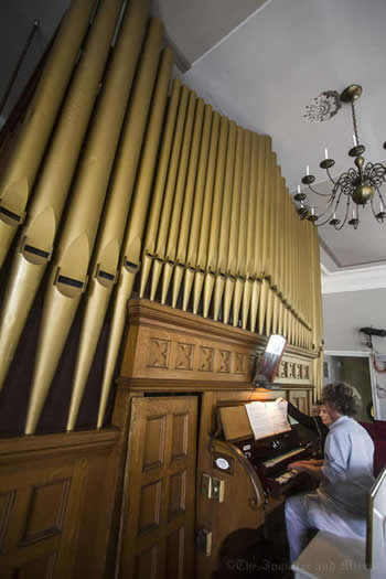 File photo Congregational Church music director Robert Behrman plays the historic Steere organ in the church's summer sanctuary. The organ is one of six featured in this year's 25th annual Nantucket Pipe Organ Crawl. I&M Photo Galleries