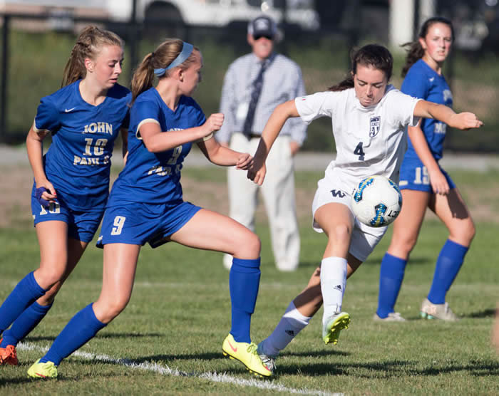 Photo by Nicole Harnishfeger Emma Pierce takes control of the ball surrounded by St. John Paul II defenders in Nantucket's season-opening 1-1 tie with the Lions last Wednesday. Sports Photo Galleries
