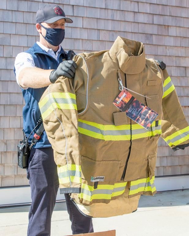 Nantucket Deputy Fire Chief Sean Mitchell reviewing a sample of new turnout gear.