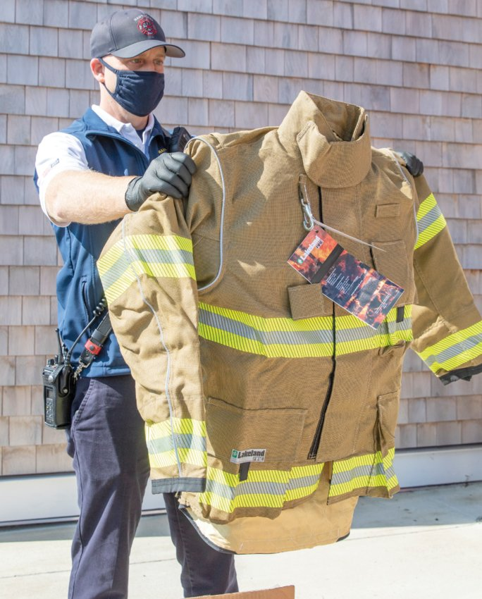 Nantucket Fire Department Capt. Sean Mitchell reviews a sample of new turnout gear.
