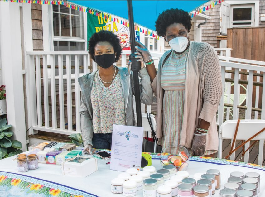 Shantaw Bloise-Murphy, left, and Bianca Brown of Supple Sirens Bath & Body (www.supplesirens.com) set up at the Sustainable Nantucket Farmers' Market last July.
