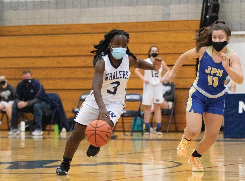 Kamoy Barnett drives through defense