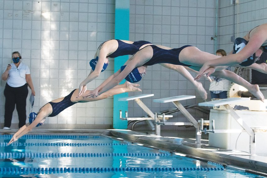 Whalers diving into the pool during Saturdays meet