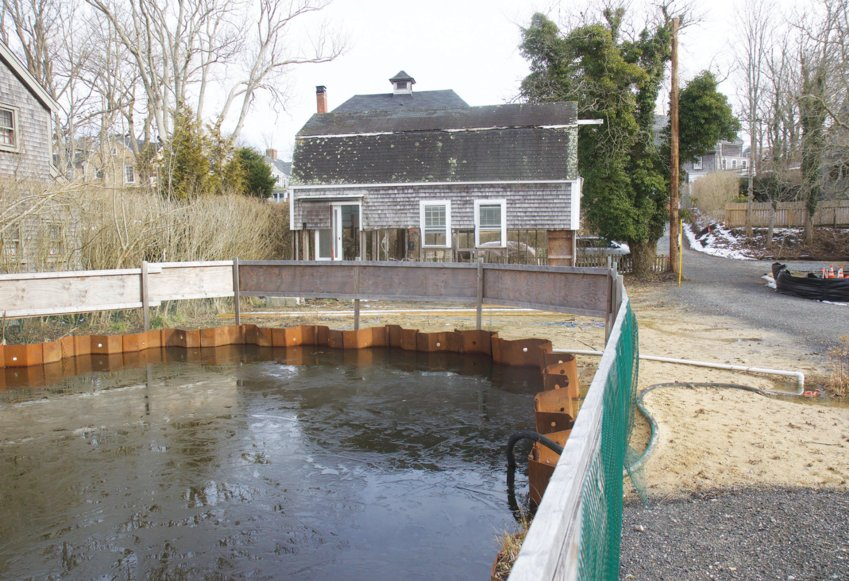 The Land Bank purchased the half-acre property at 36 Lily St. from Blue Flag Partners for $2.25 million last week. The property connects to its Lily Pond park, which Land Bank officials and neighbors say has become impassible in part because of flooding in the area.