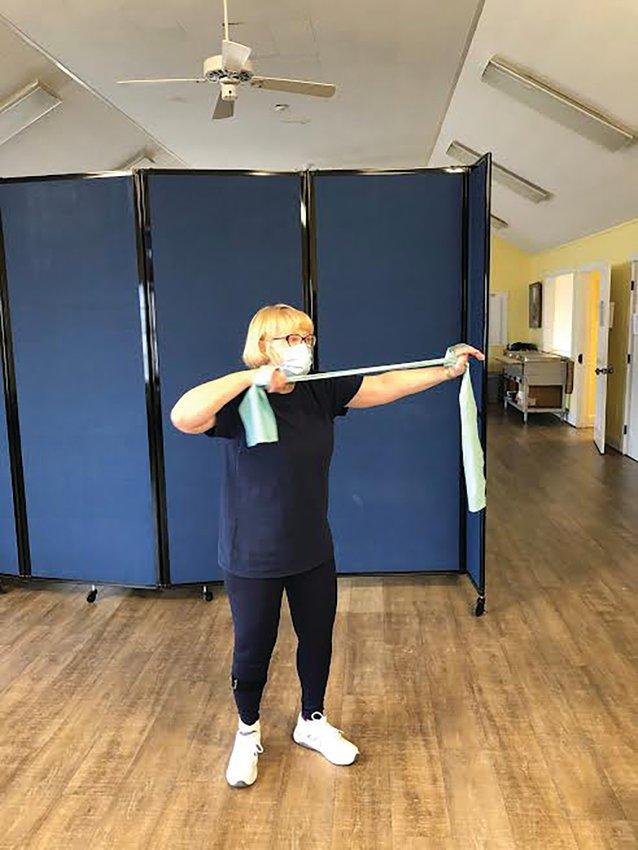 Nancy Swain leads an online senior aerobics class at an empty Saltmarsh Senior Center earlier this month.