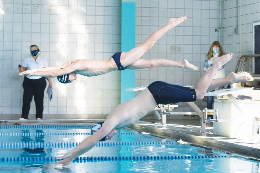 Jake Johnson and Cameron Christie dive into the pool during a virtual meet earlier this season.