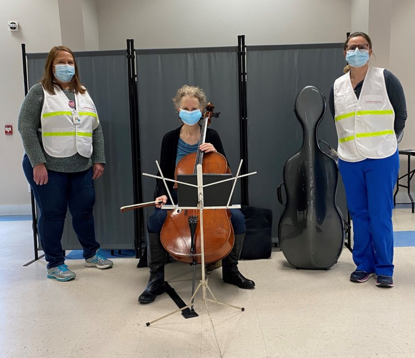 Cellist Mollie Glazer with Nantucket Cottage Hospital staff members Michele Cranston and Suzanne Carroll at the New South Road VFW vaccination site Monday.