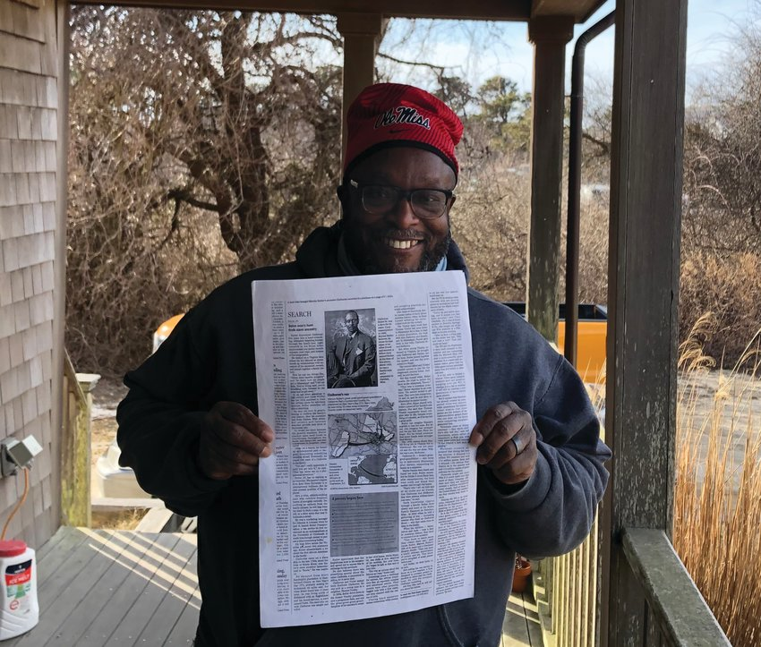 """Nantucket Equity Advocates member Moe Moore holds a newspaper clipping of his great-great grandfather, who escaped slavery in North Carolina for a free life in Mississippi. Moore will be leading an online discussion on the PBS documentary """"Reconstruction: America After the Civil War"""" this Monday at 7 p.m."""