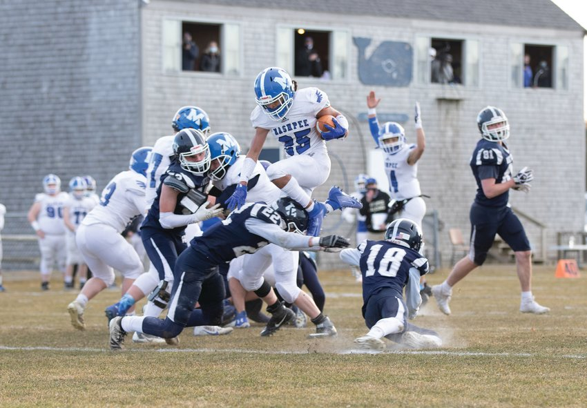Mashpee player hurdles over the Whalers for a touchdown on Friday. The Whalers lost the game 43-0.
