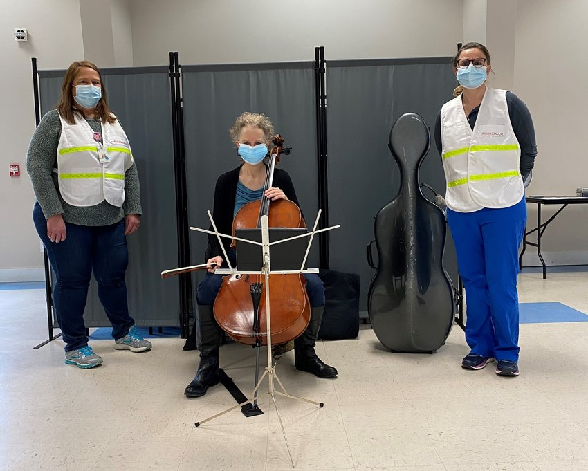 Cellist Mollie Glazer with Nantucket Cottage Hospital staff members Michele Cranston and Suzanne Carroll at the New South Road VFW vaccination site March 1.