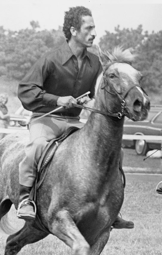 "Augusto ""Augie"" Ramos astride his horse Golden Boy. Ramos was the first person of color to be elected to the Nantucket Board of Selectmen in 1989."