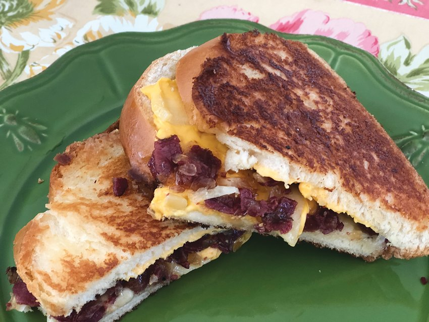 This Challah Grilled Cheese with Pastrami Jam is made with two kinds of cheese – American and Gruyère – and grilled with mayonnaise instead of butter for a perfect golden crust.