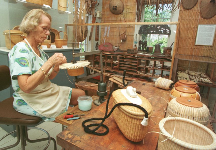 Donna Cifranic works on the top of a shoulder bag at the Nantucket Lightship Basket Museum.
