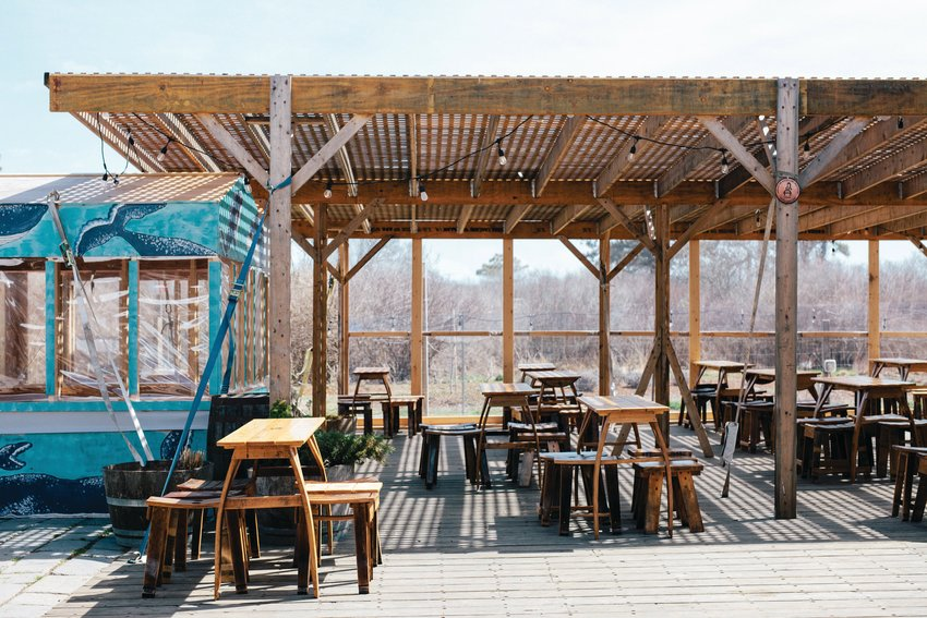 Cisco Brewers reopened last Thursday with tables spaced six feet apart, and enclosed wooden huts for people to drink in.