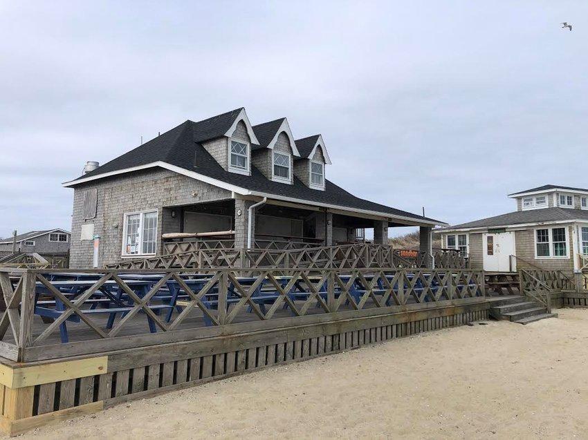 The awning at the Sandbar at Jetties Beach restaurant came down last week.