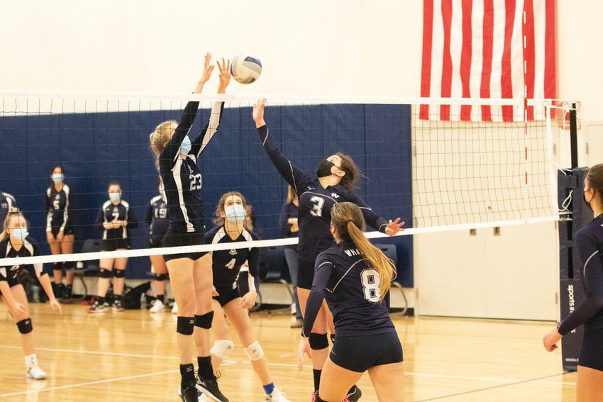Sarah Andersen (3) meets a Sturgis East player at the net in Nantucket's semifinal win over the Storm.
