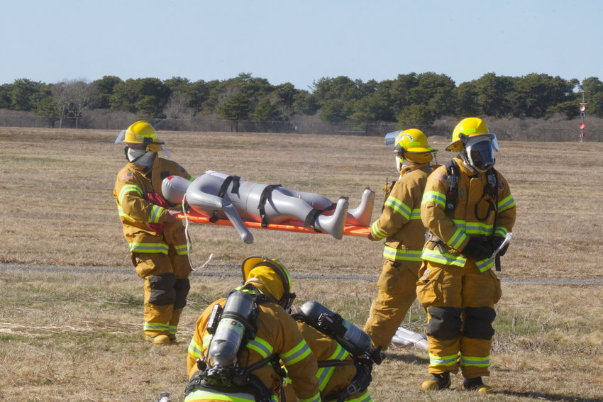 Nantucket firefighters during an airport emergency response drill Monday.