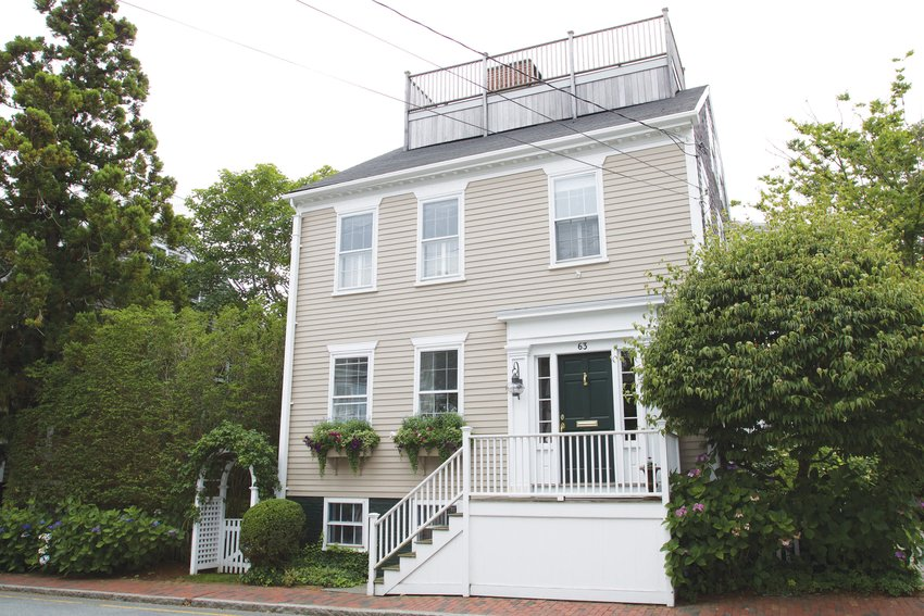 This historic Orange Street home was built in 1850 and renovated in 2004 to combine the perfect blend of modern and traditional.