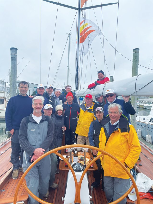 Harvey Jones, front right, and the crew of his 55-foot wooden sailboat Outlier, which won the 2021 Figawi race in the waters off Hyannis Sunday. The race did not come to Nantucket this year due to COVID-19 concerns, and was postponed a day due to high winds.