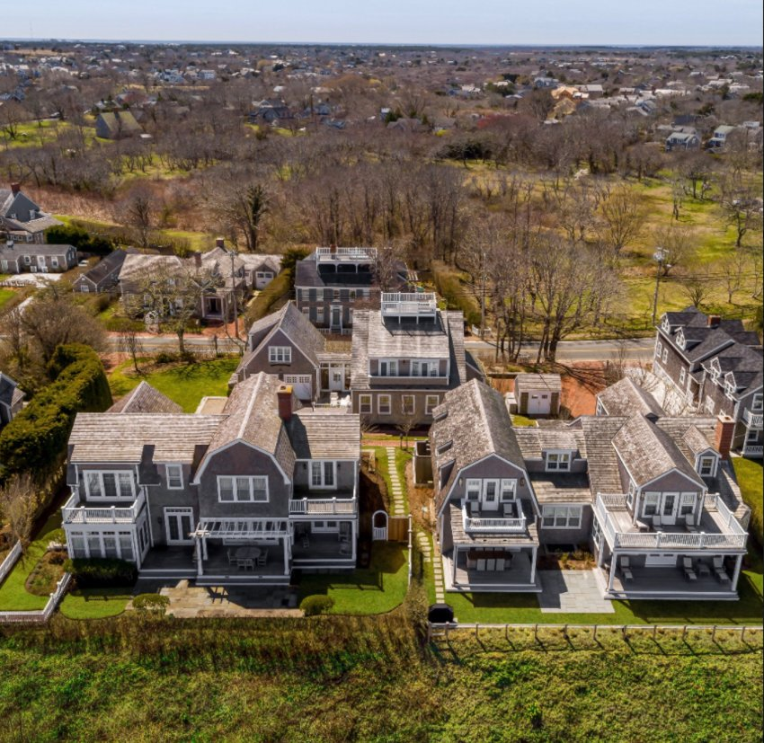 Located off prestigious Cliff Road, just steps from historic downtown Nantucket, the island's best shops and restaurants, and around the corner from several family-friendly beaches, this property has three separate homes that overlook Nantucket Sound and beyond.