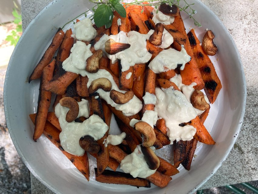 These mildly-grilled carrots are drizzled with cashew mayonnaise instead of conventional mayo.