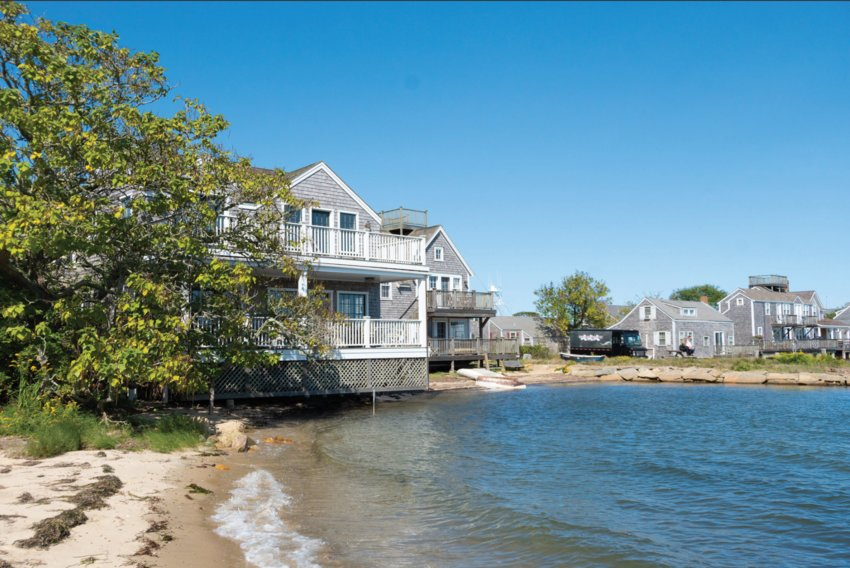 This two-bedroom, two-and-a-half bathroom home is located right on Nantucket Harbor on a quiet, cobblestone street in the heart of the downtown district.