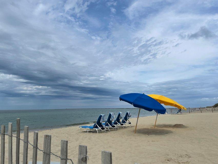 Umbrellas and chairs at Cliffside Beach await beach-goers.