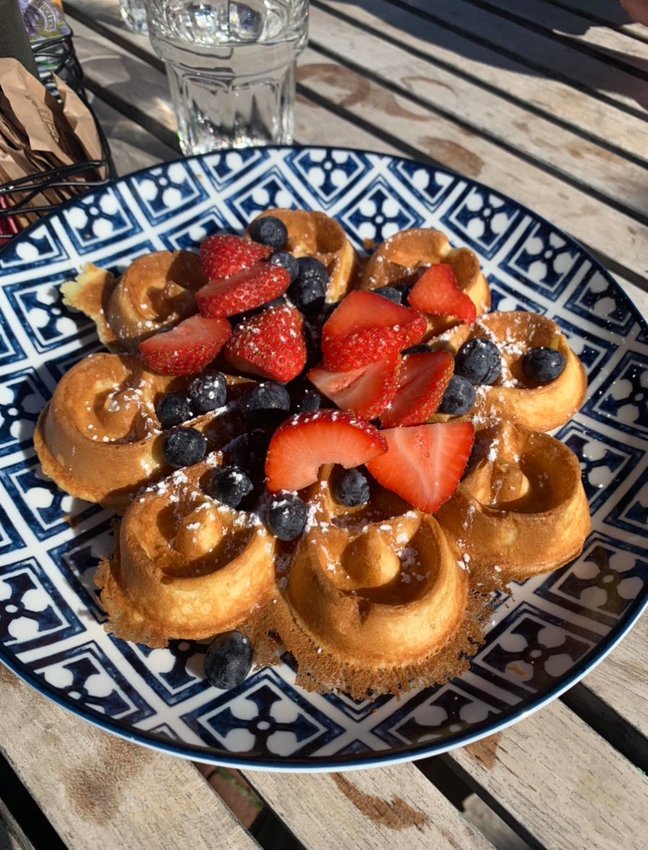 The Belgian waffle at Island Kitchen can be served with fresh berries, chocolate chips or Bananas Foster-style with caramel sauce and pecans.