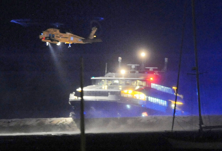 A coast guard helicopter evacuates two victims from the Iyanough at the Hyannis port breakwater June 17, 2017.