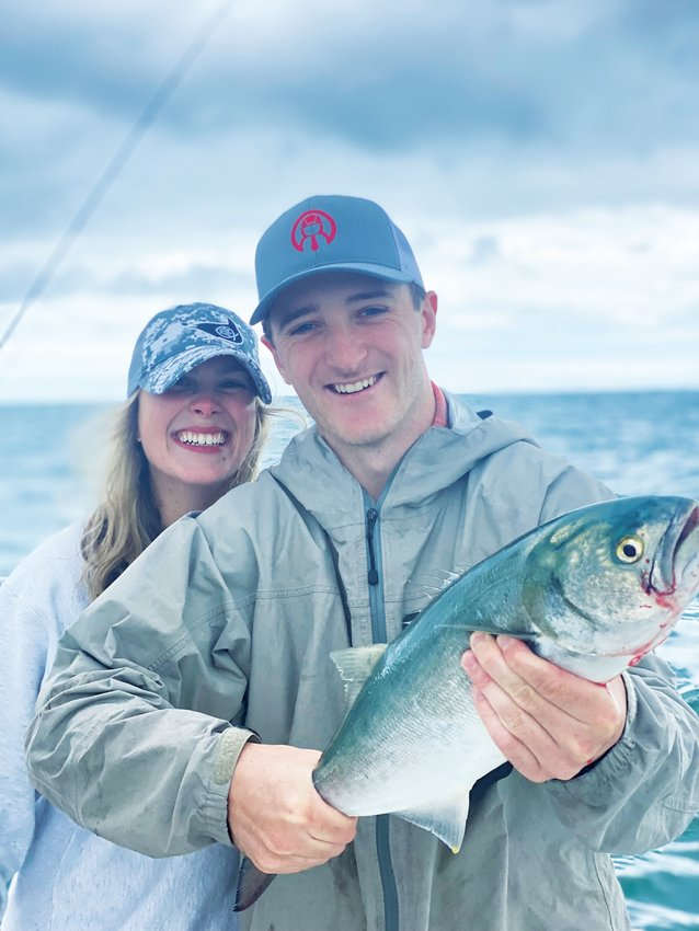 Barclay and Caroline Desloge with a big bluefish they caught on the south shore last week.