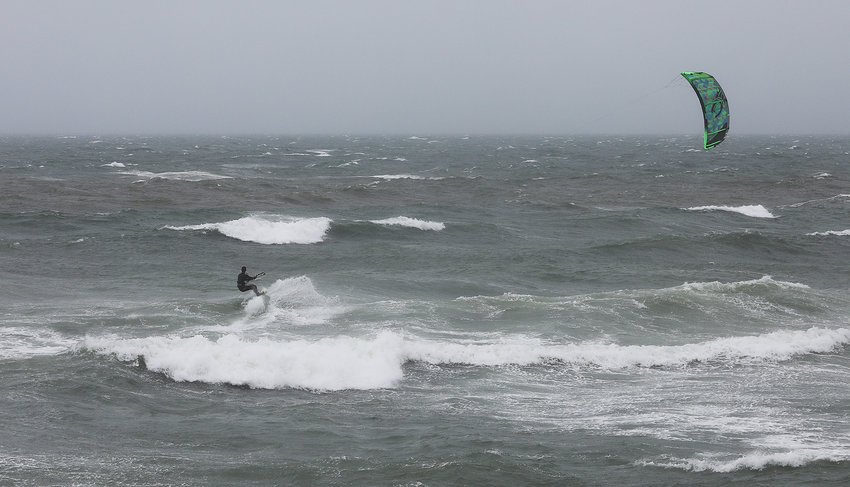 Kite surfers take advantage of the surf kicked up by Tropical Storm Elsa at Cisco Beach Friday, July 9.