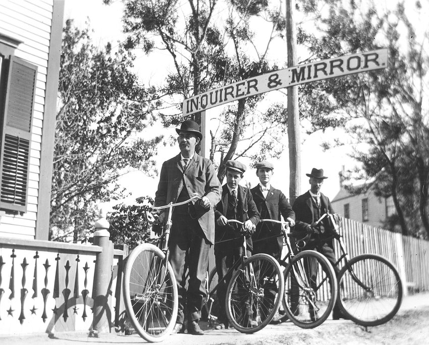 Inquirer and Mirror publisher Roland B. Hussey, 15-year-old Harry B. Turner, an unidentified friend and publisher Arthur H. Cook were part of a bicycle club in the early 1890s.