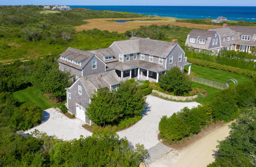 Located in the highly-sought-after Cliff Road neighborhood, off a quiet, family-friendly street, this six-bedroom, six-and-ahalf bathroom home has water views, a detached garage with a studio above and an abundance of entertainment spaces both inside and out.