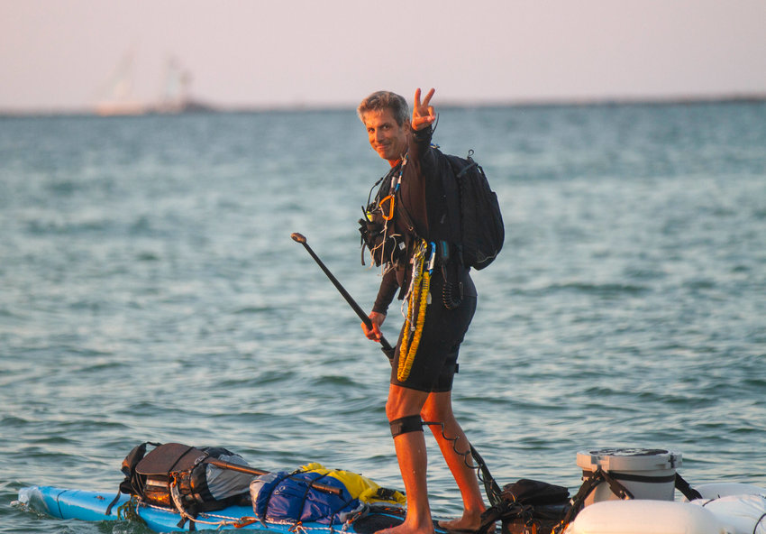 Adam Nagler flashes the peace sign as he departs from Nantucket Monday evening.
