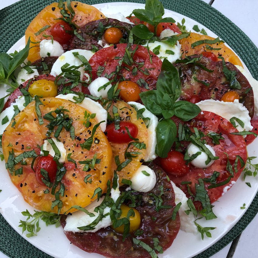 Unlike traditional Caprese Salads, this one is made with contrasting colors of heirloom tomatoes and two varieties of mozzarella cheese.