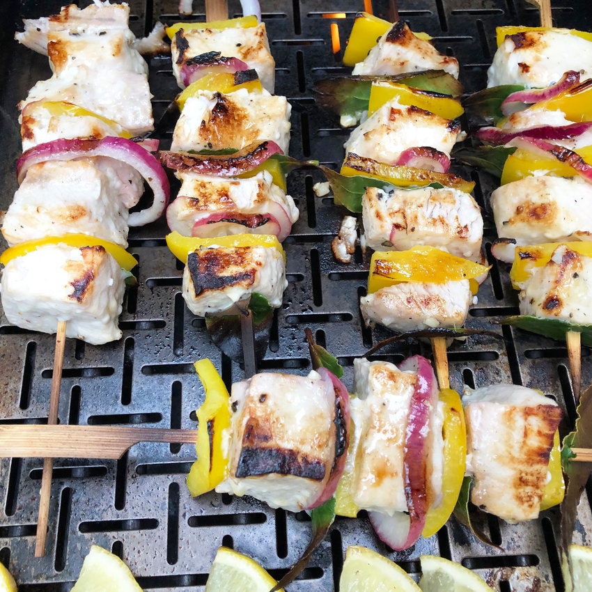 Turkish Swordfish Kebabs with Lemon and Bay Leaves are enhanced by onions and yellow bell peppers.