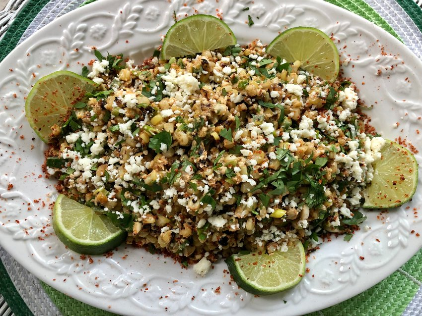 The kernels in this Mexican Corn Salad with cilantro and lime are blistered in a hot wok, rather than over a charcoal grill.