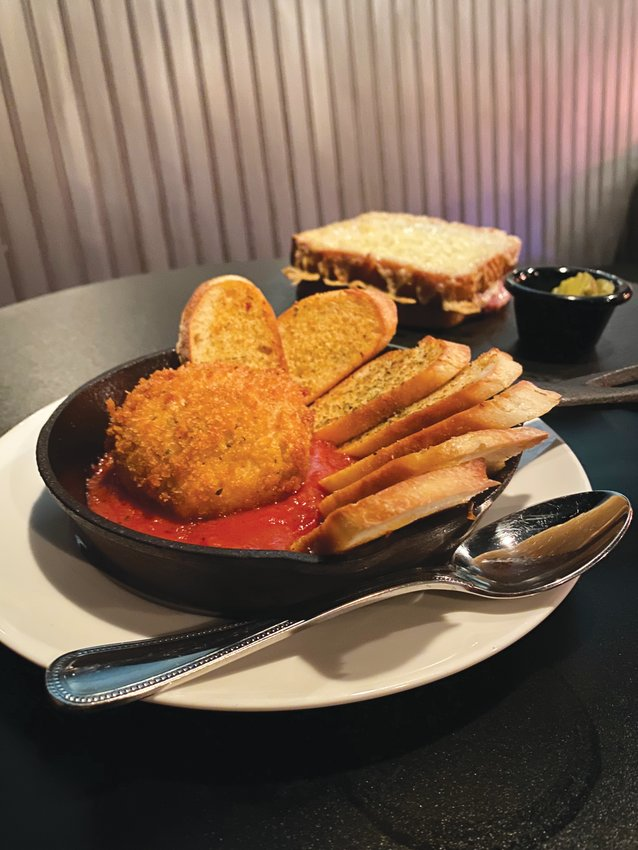 Petrichor's take on a burrata plate, front, is fried burrata in marinara with garlic crostini. The croque monsieur, back, is made with Black Forest ham and Gruyere on country bread.