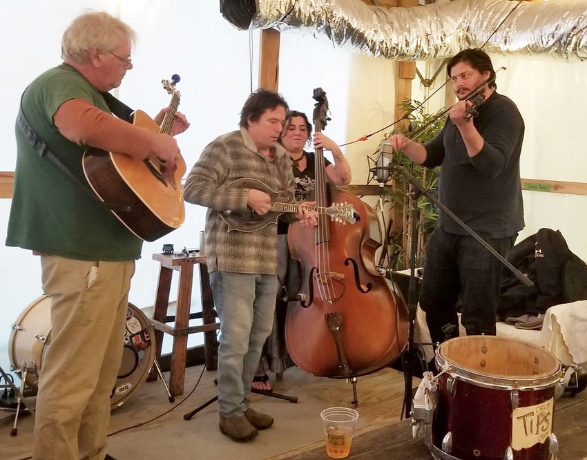 Members of Four EZ Payments from left is Bob Dickinson, Rob Dunbar, Lucy Van Arsdale and Caleb Cressman playing at Cisco Brewery last winter.