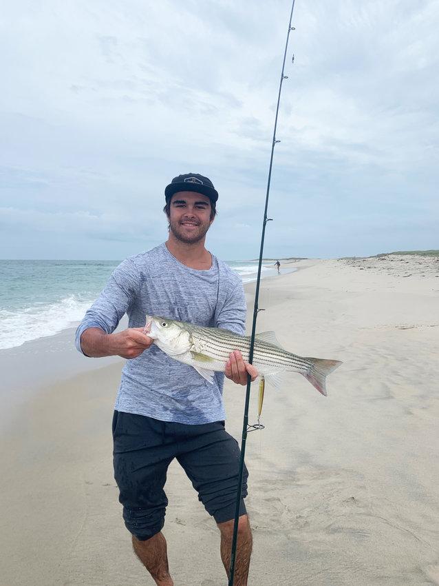 Brooks Gammill with a post-storm striped bass.