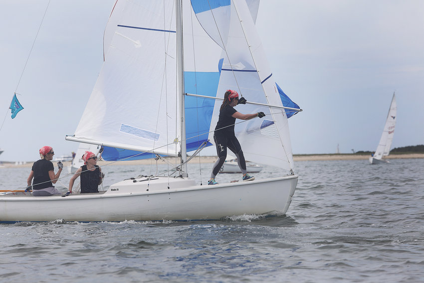 Sandy Adjick has the tiller as Hollis von Summer sets the spinnaker and Vanessa Coleman handles the lines during the 2021 Women's Regatta in the harbor on Wednesday.