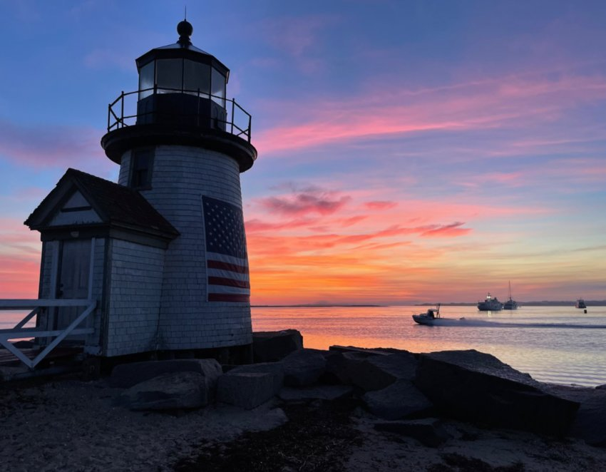 The sun rises over Brant Point Light and Nantucket Harbor last weekend.
