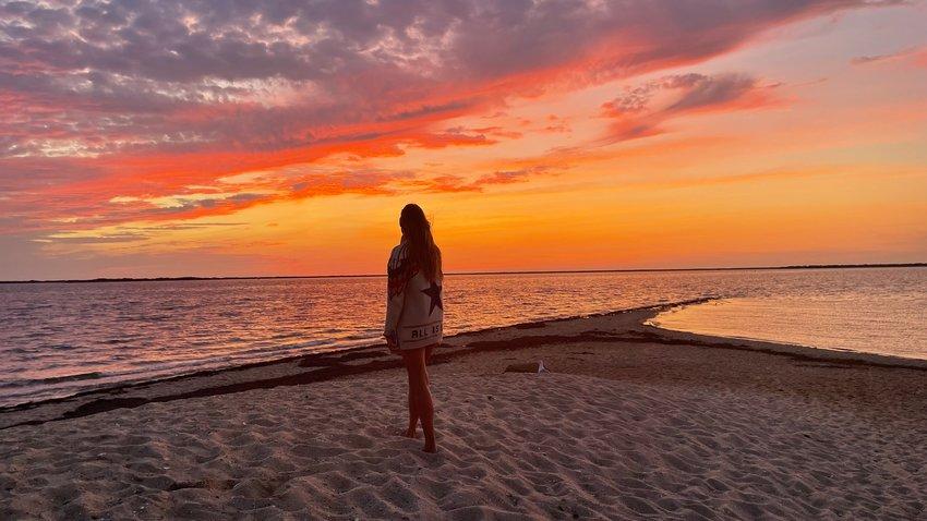 The sun sets over Pocomo Point Tuesday.