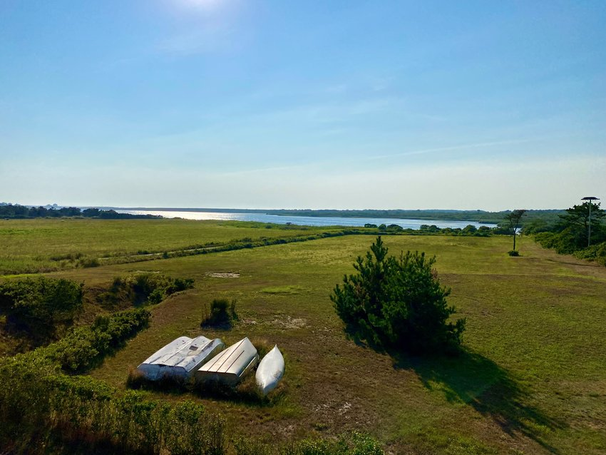 The Nantucket Land Bank on Friday purchased 4.7 acres on Hummock Pond from the Dooley family for $8.5 million. Jeanne Dooley, 89, will retain life rights to the land.